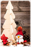 Postcard with snowman and christmas tree Royalty Free Stock Photography