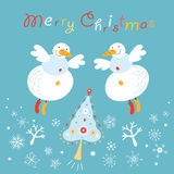 Postcard snowmen angels. Funny snowmen angels on a blue background with snowflakes and tree Stock Images
