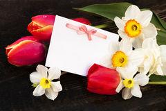 Postcard and spring flowers Royalty Free Stock Photo