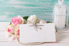 Postcard with sweet roses flowers, candle  and empty tag for you Royalty Free Stock Images