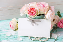 Postcard with  sweet roses flowers and empty tag for your text Stock Image