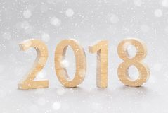Postcard template 2018 Happy New Year. numbers cut from a tree o Stock Images