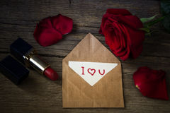 Postcard with text I love you, red lipstick, rose flower and she Royalty Free Stock Photos