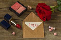 Postcard with text I love you, red lipstick, rouge, rose flower Stock Photos