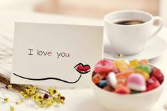 Postcard with the text I love you on a table Stock Images
