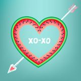 Postcard to the Valentine`s Day with text. `XOXO`. Heart on watermelon pierced by a chalk arrow Stock Image