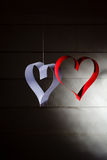 Postcard to Valentine's Day. White and red heart made of paper strips. Dark background. Royalty Free Stock Images