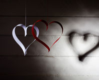 Postcard to Valentine's Day. White and red heart made of paper strips. Dark background. Royalty Free Stock Photos