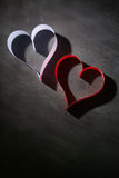 Postcard to Valentine's Day. White and red heart made of paper strips. Dark background. Royalty Free Stock Image