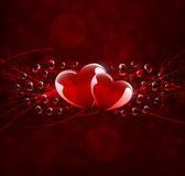 Postcard with two hearts on dark red background Stock Photos