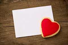 Postcard for Valentine's day, cookie heart on paper Stock Image