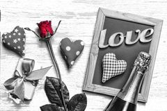 Postcard Valentine`s day. Homemade hearts, roses, decorative frame, gift box with bow and champagne on a light wooden background,. Top view Royalty Free Stock Photo