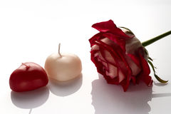 Postcard on Valentine`s Day, a rose and a candle in the form of Royalty Free Stock Photos