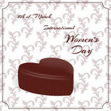 Postcard with white patterns. Chocolate candy in the shape of a heart and an inscription with the International Women`s Day on Mar. Ch 8. Vector royalty free illustration