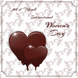 Postcard with white patterns. Melting chocolate candy in the shape of a heart and an inscription with the International Women`s Da Royalty Free Stock Photo