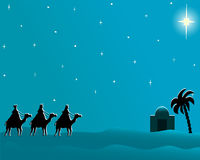 Postcard wisemen to Bethlehem. Christmas card in blue with copyspace to message on three wisemen going to Bethlehem following the brighten star Royalty Free Stock Image