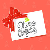 Postcard with the words Merry Christmas. Christmas greeting card with the words Merry Christmas on a red background Stock Image