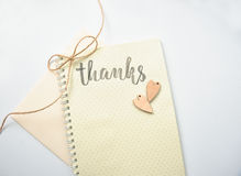 Postcard with the words thanks on a paper background with two hearts Stock Images