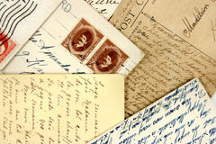 Postcards and arabic stamps. Set of vintage postcards with nice hand writing Royalty Free Stock Photo
