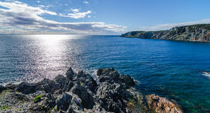 Postcards from Bonavista, Sun shines on Atlantic Ocean.  View of cove and Atlantic from a high cliff in Crow Head, Royalty Free Stock Image