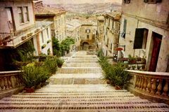 Postcards from Italy (series). Artistic work of my own in retro style - Postcard from Italy. - Beautiful staircase Corinaldo, Italy Stock Photography