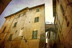 Postcards from Italy (series). Artistic work of my own in retro style - Postcard from Italy. - Architecture urban alley, Spoleto, Umbria, Italy Royalty Free Stock Images