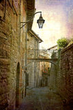 Postcards from Italy (series). Artistic work of my own in retro style - Postcard from Italy. - Architecture urban alley, Gubbio, Umbria, Italy Stock Image