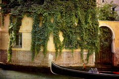 Postcards from Italy (series). Artistic work of my own in retro style - Postcard from Italy. - Ivy and gondola - Venice Stock Images