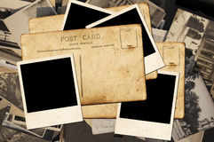 Postcards and photos. Many old postcards and photos on a plane Royalty Free Stock Photos