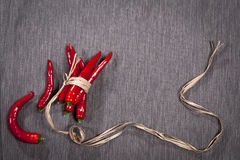 The Postcards for recipes. Red chile pepper, tied with twine, on a gray napkin. Copy space Royalty Free Stock Image