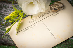 Postcards with ring and flowers on the wooden table. Horizontal stock photos