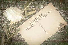 Postcards with ring and flowers on the wooden table top view. Horizontal royalty free stock images