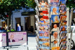 Postcards stand in Rome. Kiosk with various postcards with images of Rome and religious. Via Veneto in Rome Stock Photography