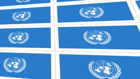 Postcards with United Nations flag. Sheet of postcards with international flag of UN. Symbol of United Nations Organization stock video footage