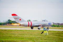 Postcombustore pieno Mig-17 sul decollo Fotografia Stock
