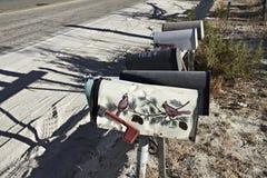 postdozen op een rij bij de woestijn de V.S. van Arizona stock foto's