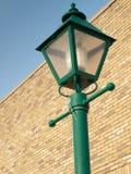 Poste de la lámpara en ladrillo Imágenes de archivo libres de regalías