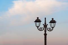 Poste de luz no por do sol Fotografia de Stock Royalty Free