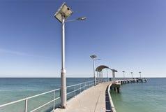 Poste de luz solar da rua Fotos de Stock Royalty Free