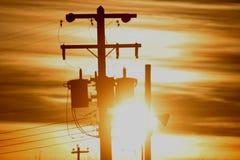 Poste de potencia en silueta Imagenes de archivo