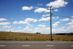 Poste de teléfono con los alambres Foto de archivo libre de regalías