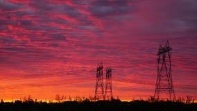 Poste di energia nell'alba Immagine Stock Libera da Diritti