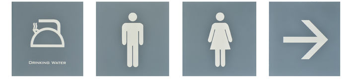 Poste indicador al wc Imagenes de archivo