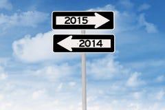 Poste indicador con el número 2015 y 2014 Foto de archivo libre de regalías