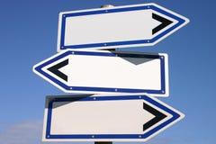 Poste indicador de tres vías en blanco de la dirección Foto de archivo