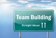 Poste indicador Team Building de la carretera Foto de archivo libre de regalías