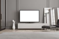 Poste TV d'écran blanc dans un salon Image stock