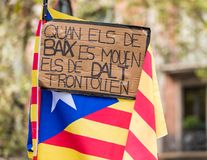 Poster against the background of the Catalan flag at the demonstration, Barcelona, Catalunya, Spain. Royalty Free Stock Photos