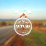 Poster with autumn landscape. EPS,JPG. Poster with autumn landscape. Motto, slogan for autumn season. Maple leaves on a autumn road background. Emblem for Royalty Free Stock Photo