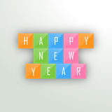 Poster, banner or flyer for Happy New Year celebrations. Happy New Year celebrations with wishing text over colorful blocks on grey background, can be used as Royalty Free Stock Images